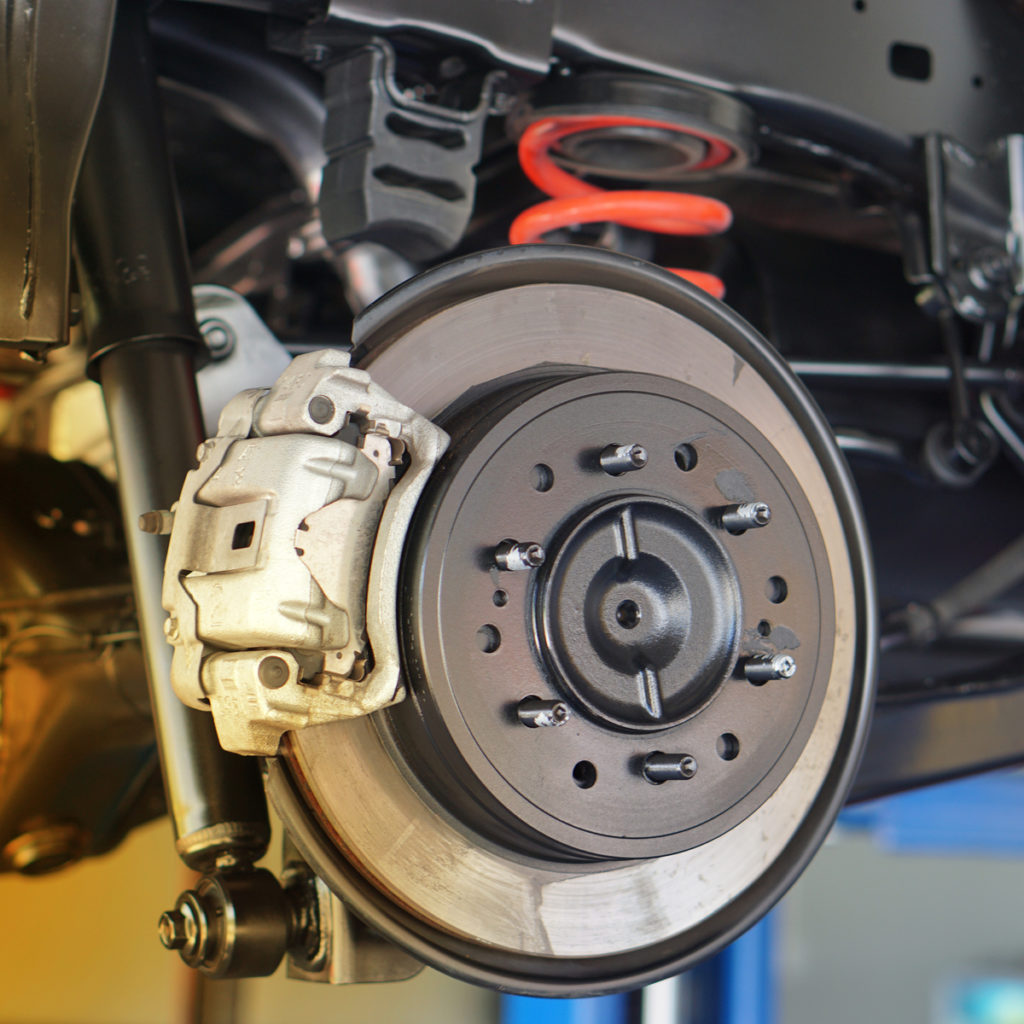 Disc brake of the vehicle for repair, in process of new tire replacement